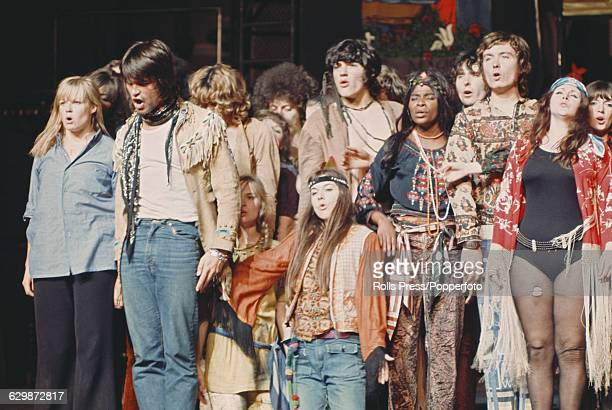 View of cast members performing on stage in the West End production of the musical stage show 'Hair' at the Shaftesbury Theatre in London soon after...