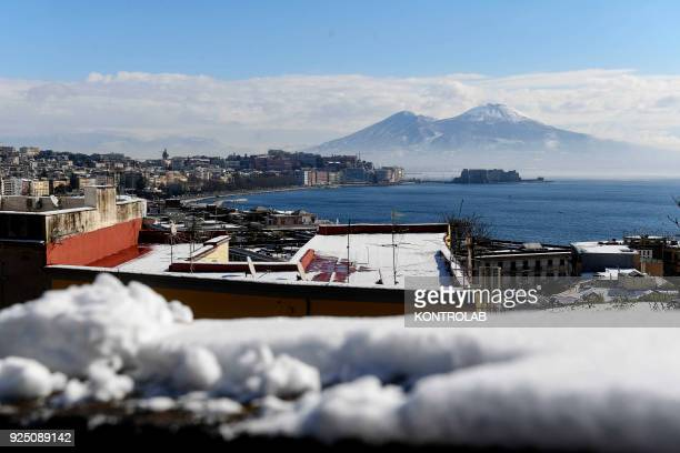 A view of Castello dell' ovo and Vesuvius during the extraordinary snowfall that has whitened the city Bad weather comes from the Siberian region and...