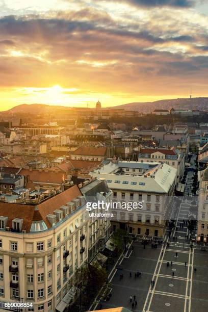 View of Castle Hill and Zrinyi Street in Budapest at sunset