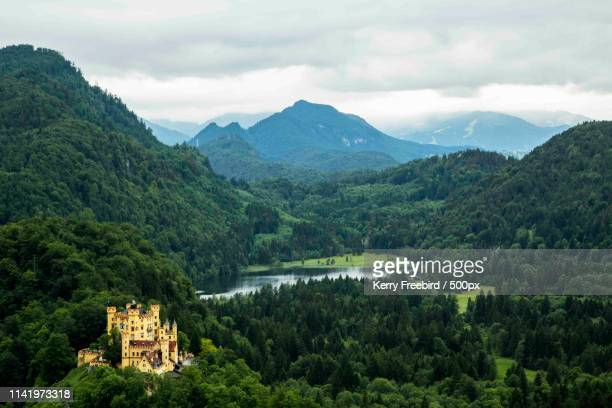 view of castle on mountain area - castle mountain stock photos and pictures