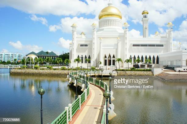 view of cathedral against cloudy sky - bandar seri begawan stock photos and pictures