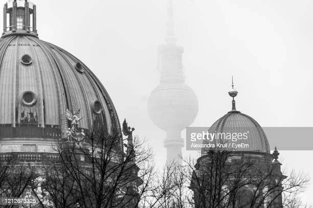 view of cathedral against sky in city - alexandra krull stock-fotos und bilder