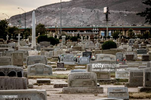 view of cemetery against built structure - steven cottingham stock-fotos und bilder