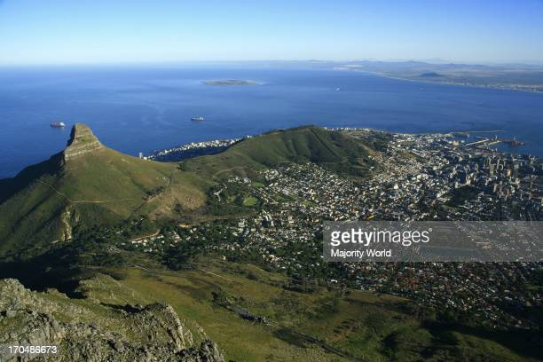 view of central Cape Town from the top of Table Mountain with Lions Head and Robben Island where Nelson Mandela was imprisoned in the distance Cape...
