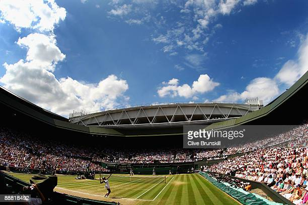 A view of Centre Court as Venus Williams of USA serves during the women's singles final match against Serena Williams of USA on Day Twelve of the...