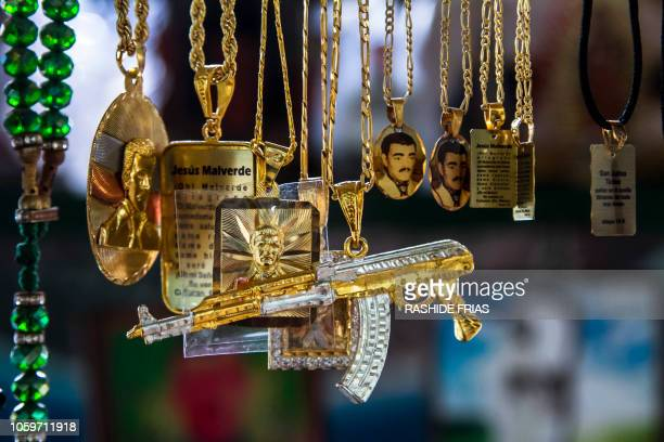 View of chains with the figure of narcosaint Jesus Malverde are displayed for sale at his chapel in Culiacan Sinaloa state Mexico on October 22 2018...