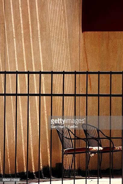View Of Chair Through Fence