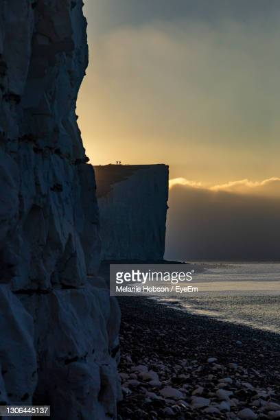 a view of chalk cliffs on the sussex coast at sunrise - west indies stock pictures, royalty-free photos & images