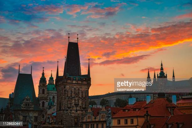 view of charles bridge in prague during sunset, czech republic. - hradcany castle stock pictures, royalty-free photos & images