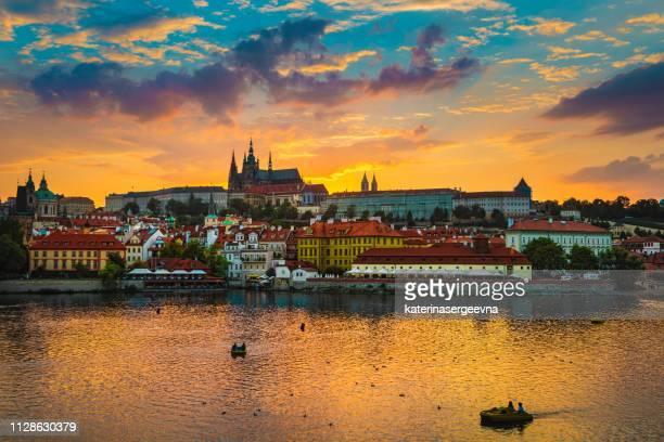 view of charles bridge in prague during sunset, river vltava czech republic. - vltava river stock photos and pictures