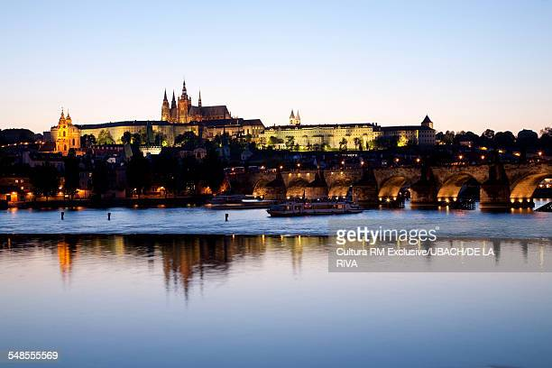View of Charles IV Bridge and river Vltava at dusk, Prague, Czech Republic