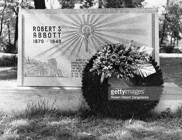 View of Chicago Defender newspaper founder Robert Sengstacke Abbott's grave in Lincoln Cemetery, Blue Island, Illinois, 1950.