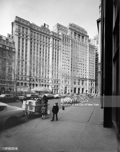 View of children at a food cart with the Cunard Building at 25 Broadway in the background New York New York circa 1975