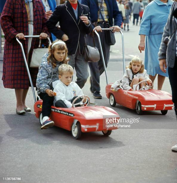 View of children in Hertzbranded strollers as they are pushed through the World's Fair in Flushing Meadows Park in Queens New York New York April 1965