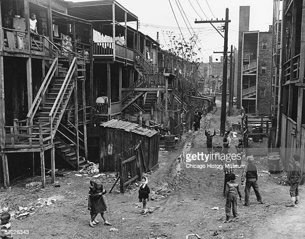 View of children playing on a muddy back street alley in the 500 block of Thrityseventh street in Chicago 1951 The slum conditions prompted the...