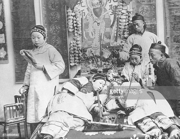"View of Chinese smoking the ""evil poppy"" in an opium den. Undated photograph."