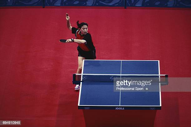 View of Chinese table tennis player Wang Nan in action to win the gold medal in the final of the Women's singles table tennis event against fellow...
