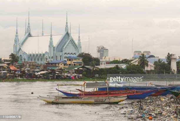 A view of Christchurch in San Nicolas and fishing boats on the Pasig River The Batangas Shipping and Engineering Company Compound is the largest...