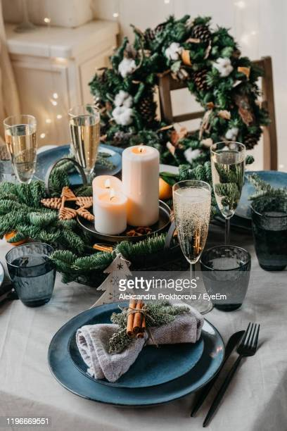 view of christmas decorations on table - christmas decore candle stock pictures, royalty-free photos & images