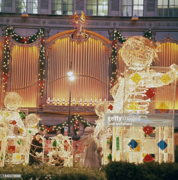 View of Christmas decorations on the promenade at Rockefeller Center in midtown Manhattan, New York, New York, December 1969. Also visible are...