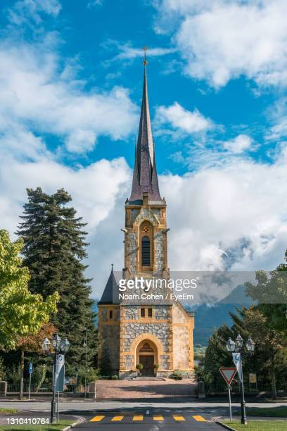 view of church against cloudy sky - bad ragaz stock pictures, royalty-free photos & images