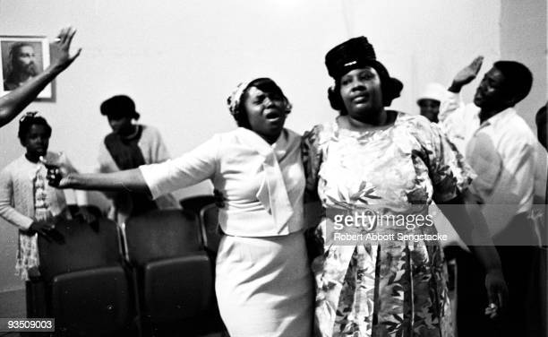 View of church goers dancing and singing while participating in a religious service at the Temple Apostolic Church a storefront church in Chicago IL...