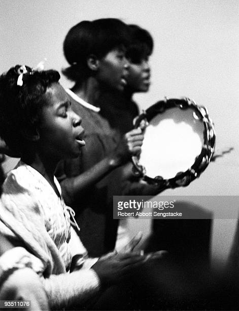 View of church goers dancing and singing while participating in a religious service at the Christ Temple Apostolic Church a storefront church in...