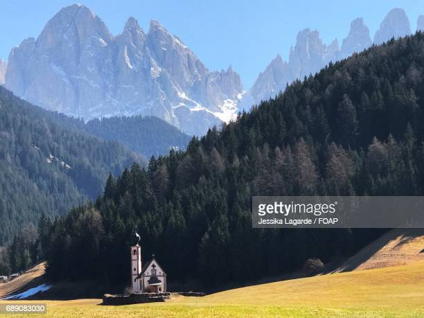 view of church in dolomite, italy - lagarde stock photos and pictures