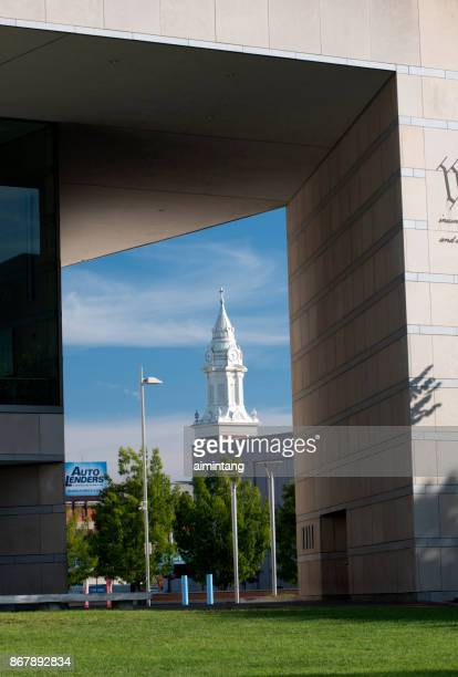 view of church tower through the building of national constitution center - national constitution center stock pictures, royalty-free photos & images