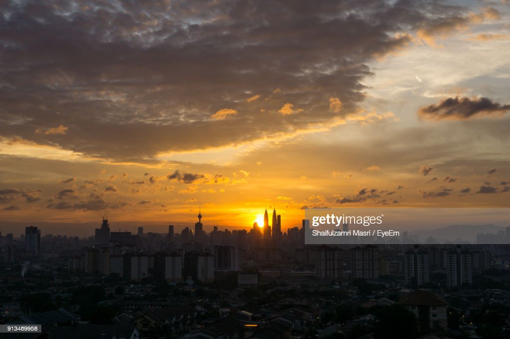 View Of City Against Cloudy Sky During Sunset : Stock Photo