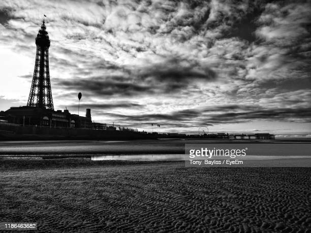 view of city against cloudy sky - blackpool stock pictures, royalty-free photos & images