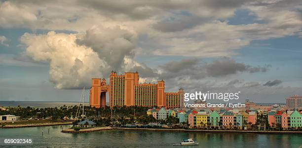 view of city against cloudy sky - nassau stock photos and pictures