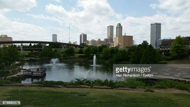 view of city against cloudy sky - tulsa stock pictures, royalty-free photos & images