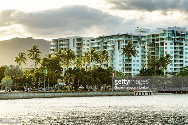 view of city against cloudy sky - cairns stock photos and pictures