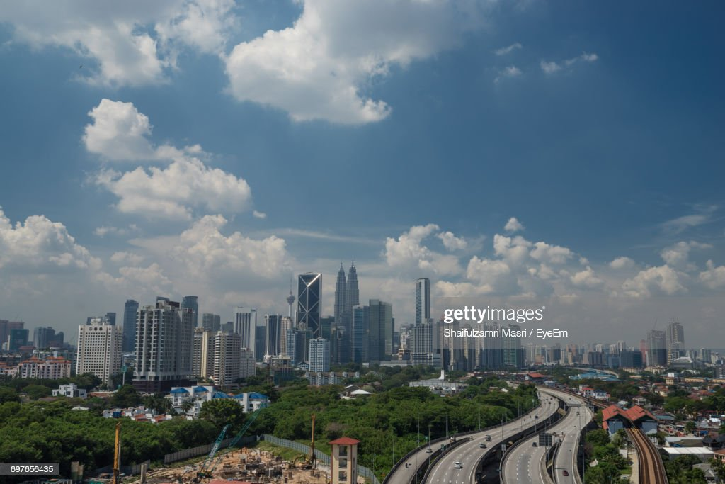 View Of City Against Cloudy Sky : Stock Photo