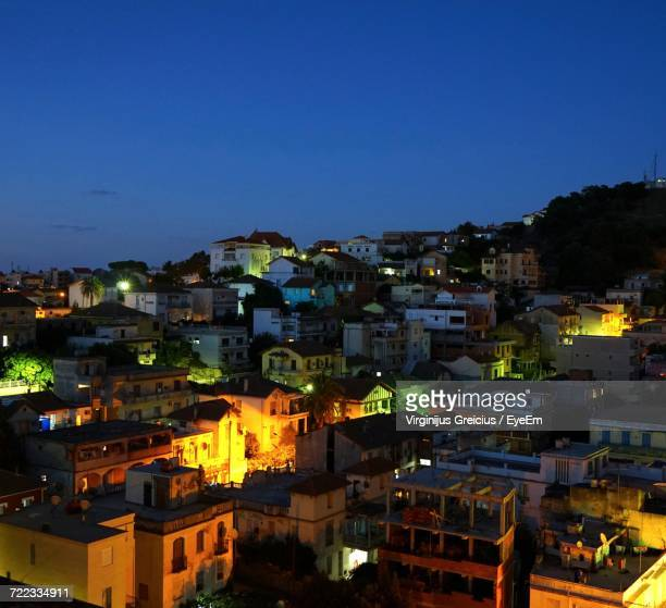 view of city at night - annaba algeria foto e immagini stock