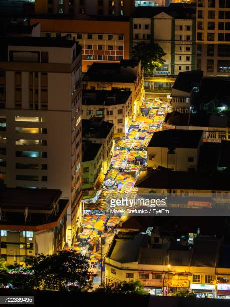 view of city at night - marek stefunko stock photos and pictures