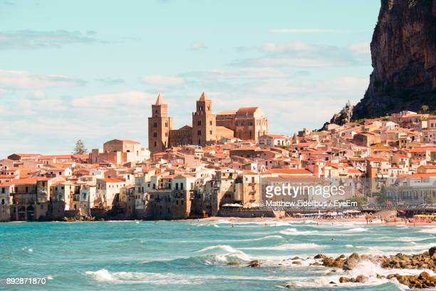 view of city at seaside - sicilia foto e immagini stock