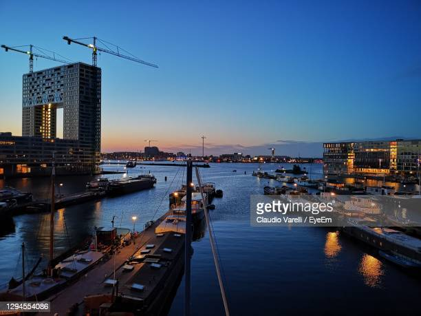 view of city at sunset - amsterdam stock pictures, royalty-free photos & images
