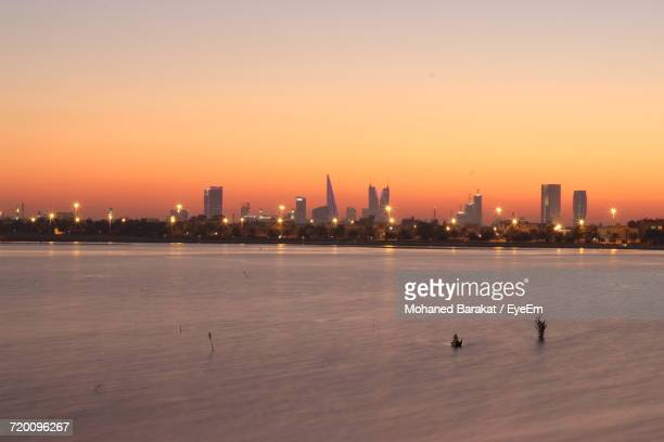 view of city at sunset - bahrain stock pictures, royalty-free photos & images