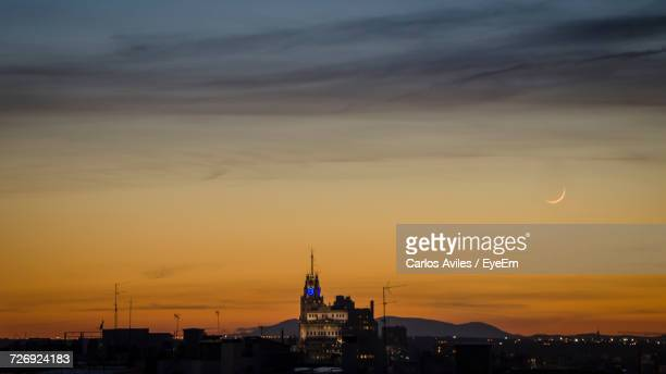 view of city at sunset - carlos aviles stock pictures, royalty-free photos & images