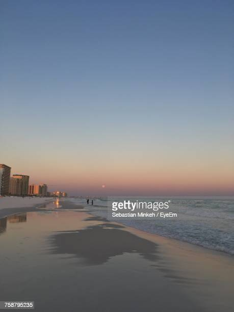 view of city at sunset - destin beach stock pictures, royalty-free photos & images