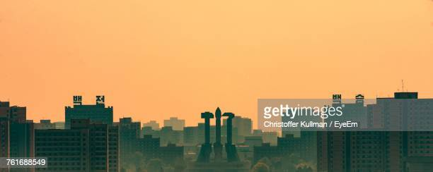 view of city at sunset - north korea stock pictures, royalty-free photos & images