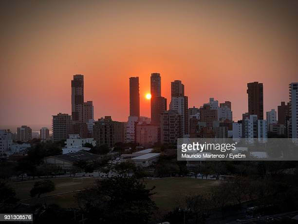 view of city at sunset - barranquilla stock photos and pictures