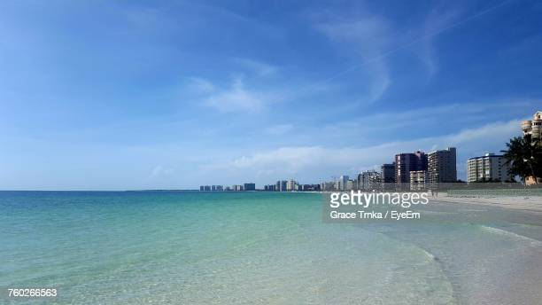 view of city at waterfront against blue sky - marco island stock pictures, royalty-free photos & images