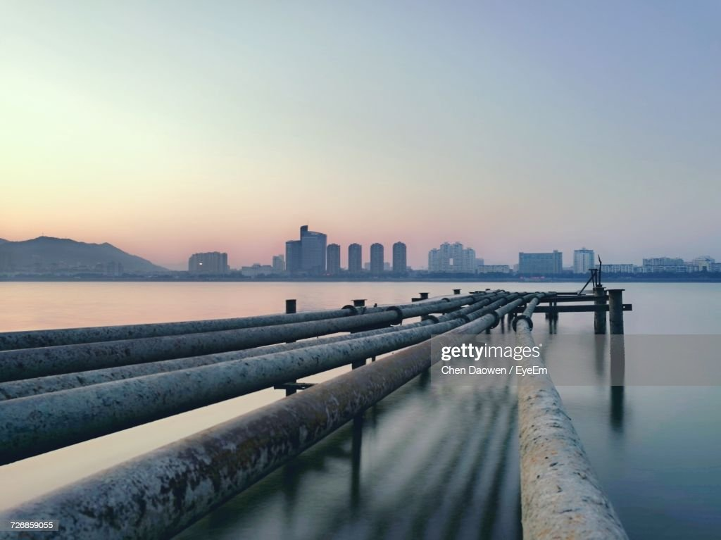 View Of City At Waterfront During Sunset : Stock Photo