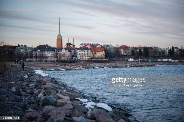 View Of City At Waterfront During Winter