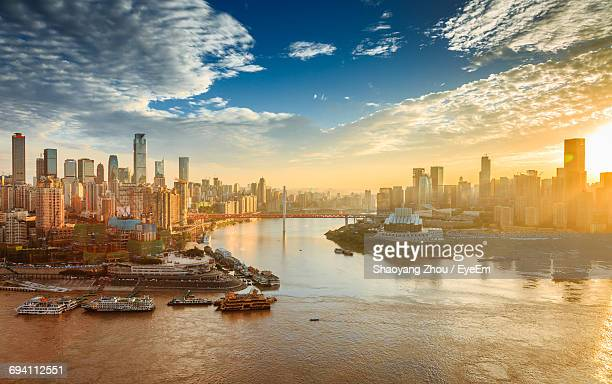 view of city at waterfront - chongqing stock photos and pictures