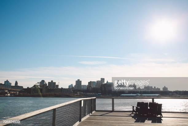 view of city at waterfront - bortes foto e immagini stock