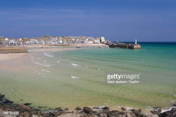 view of city at waterfront - st ives stock pictures, royalty-free photos & images